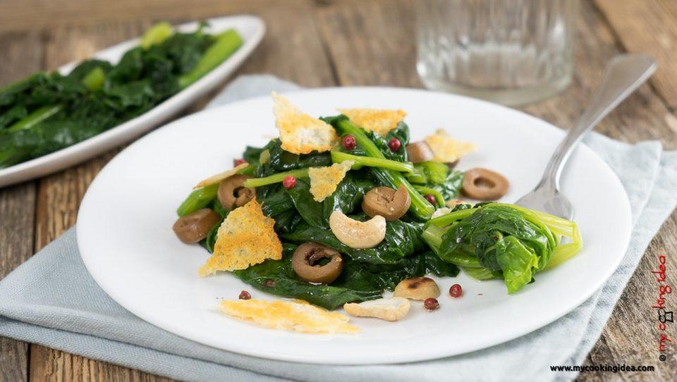 Spinaci saporiti con olive e anacardi | Ricetta facile